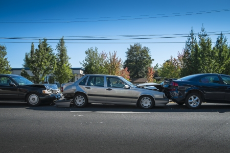 Three cars involved in an accident on a city street