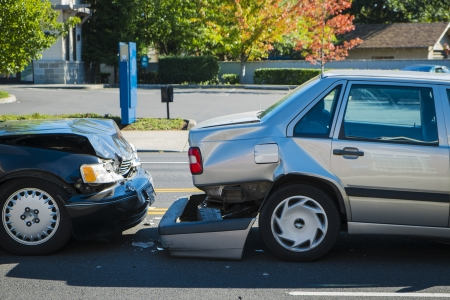 involving: Auto accident involving two cars on a city street