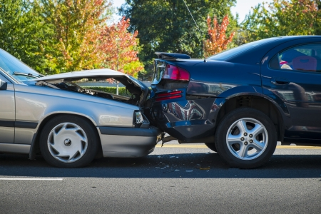 car wreck: Auto accident involving two cars on a city street