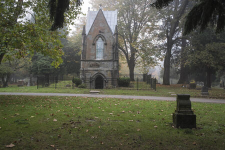Mausoleum in a foggy old Pioneer Cemetery covered Stock Photo