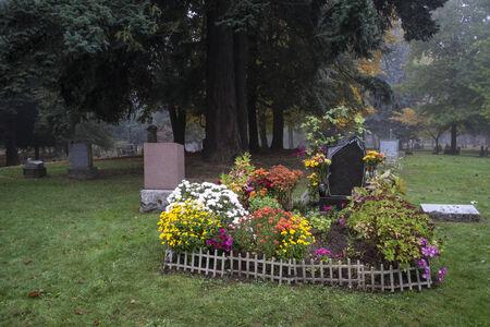 gravesite: Gravesite in an old Pioneer Cemetery full of flowers Stock Photo