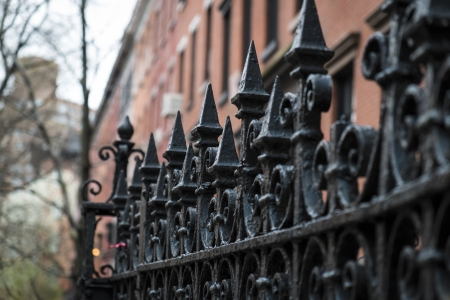 multifamily: Black wrought iron fence in New York City