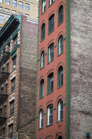 multifamily: Old red brick apartment buildings in New York City