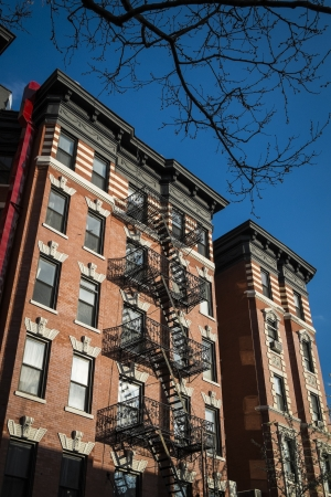 apartment: Classic old apartment building with fire escape, New York City Editorial