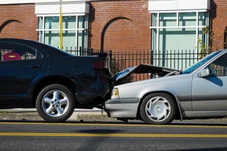 Auto accident involving two cars on a city street photo