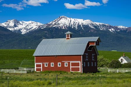 Red barn near the Wallowa Mountains in Oregon