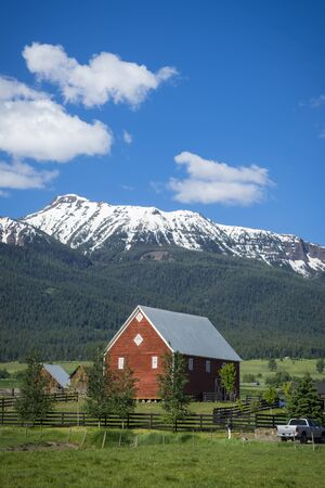 red barn: Red barn near Wallowa Mountains in Oregon Stock Photo