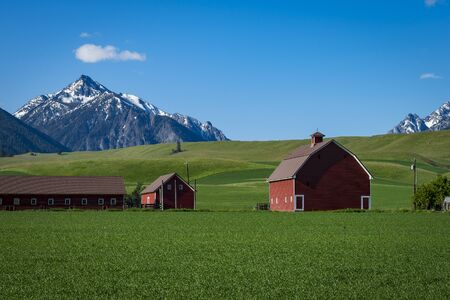 countryside landscape: Red barn near the Wallowa Mountains in Oregon