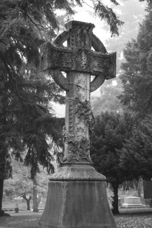 christian halloween: Large statue of a cross in an old Pioneer Cemetery Stock Photo