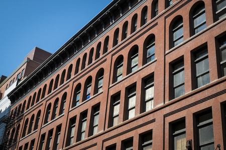 multifamily: Old red brick building in New York City