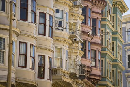 multifamily: Colorful Victorian apartments in San Francisco, California