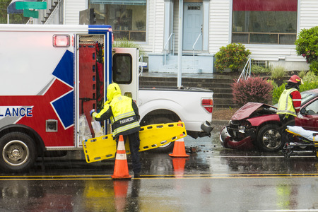 responding: EMT personnel responding to a traffic accident in the rain