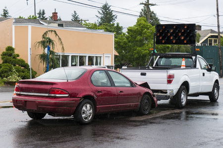 fender bender: Traffic accident in the rain between a signal truck in the passenger car