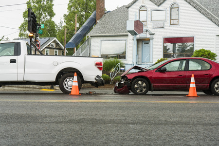 fender bender: Traffic accident in the rain between a passenger car in the pickup truck Stock Photo