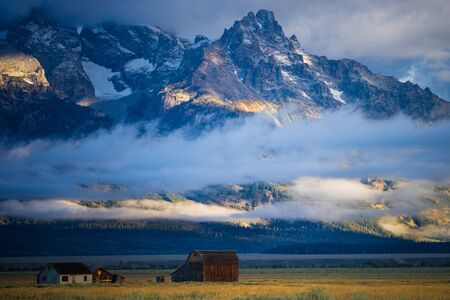 sagebrush: Barn and fields of grass and sagebrush, Grand Teton National Park, Wyoming Editorial