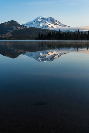 cascade range: Mountains in the cascade Range of Oregon reflected in a lake Stock Photo