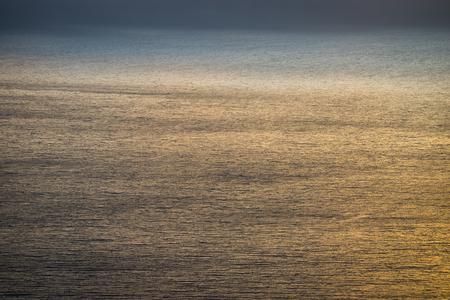 sur: Sunset-tinted ocean waves at Big Sur, California