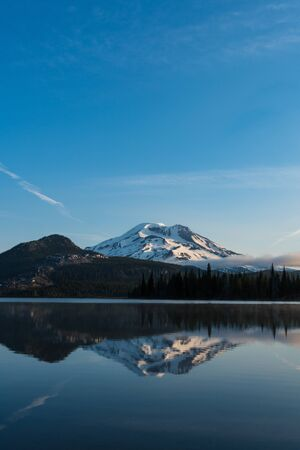 Mountains in the cascade Range of Oregon reflected in a lake Stock Photo