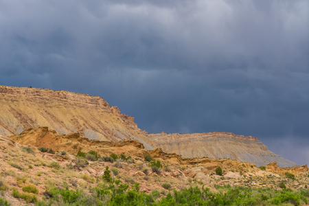Storm clouds gathering above gravel road to southern Utah