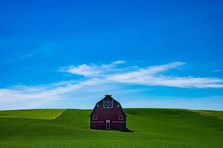 Red barn in a field in yhe Palouse region of eastern Washington state