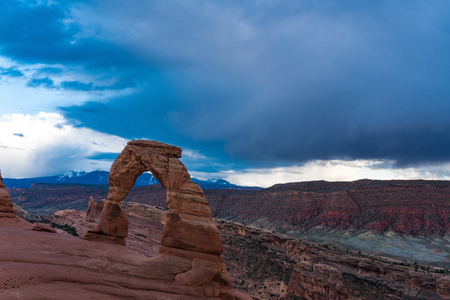 Delicate arch in Utahs Arches national Park, beneath a stormy sky