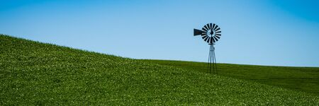 Landscape with the windmill and wheat fields in Eastern Washington state