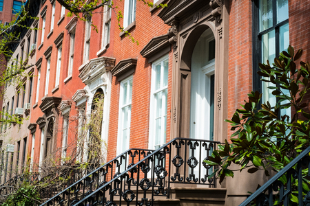 multifamily: Entrances to red brick apartment buildings in New York City Stock Photo