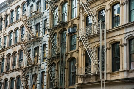 Office building with fire escapes in Soho district of New York City