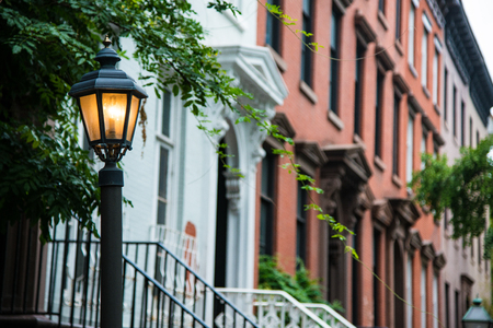 Vintage lamp post near old apartment buildings in Greenwich Village, New York City Stock Photo