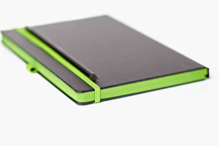 notebook with pencil booklet, black green