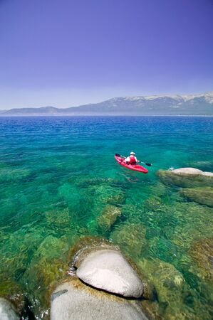 nevada: Kayak on clear water and sky on Lake Tahoe