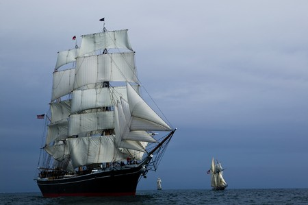 Tall Ship under sail with the shore in the background Stock Photo - 3950809