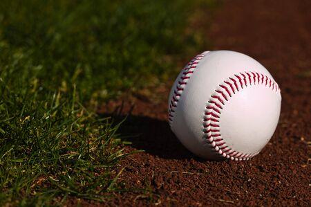 Baseball on the green grass of a ball field Stok Fotoğraf - 3951080