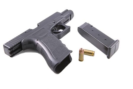 casings: 9mm handgun with shell casings on a white background
