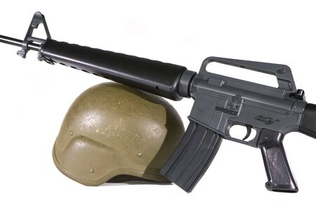 Bullet proof helmet with an M16 rifle on a white background