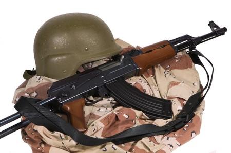 sunni: Current Iraqi Army Desert Camoflage Uniform with AK-47 Rilfe and Kelvar Helmet