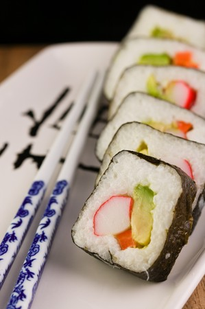 Sushi California Spring Rolls on a japanese plate with chopsticks Stok Fotoğraf