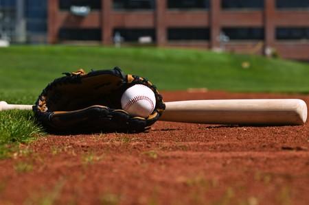 Baseball, Glove, and bat on a ball field