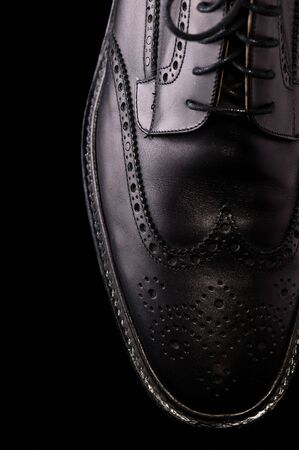Black Leather Shoe on Black Background Stok Fotoğraf
