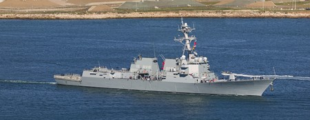 Arleigh Burke-class guided missile destroyer leaving port. Stock Photo