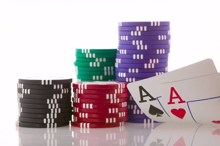 Stack of poker chips and two aces.