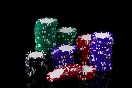 Stack of poker chips on a black background Stok Fotoğraf
