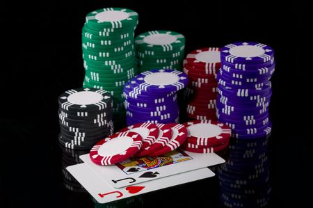Stack of poker chips and two jacks.