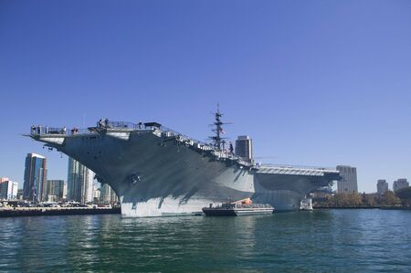 midway: USS Midway CV-41 aircraft carrier docking in San Diego Bay