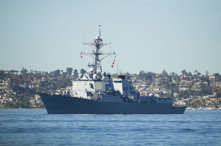 destroyer: Arleigh Burke-class guided missile destroyer leaving port. Stock Photo
