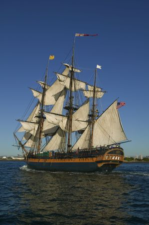 Tall Sailing Ship with shoreline in the background