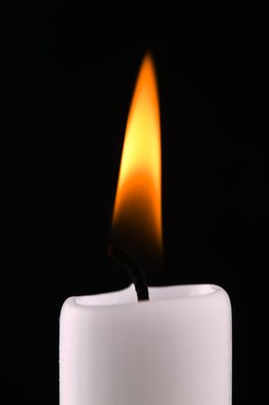 A candle on a black background