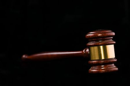 juror: Isolated gavel on black background