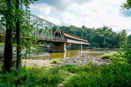 This is Harpersfield Covered Bridge that spans the Grand River in northeast Ohio the bridge is over a hundred years old and cars still cross it every day.