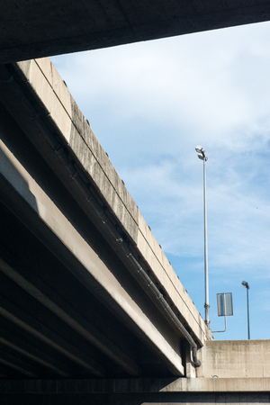 colum: Modern concrete elevated road way or overpass system.